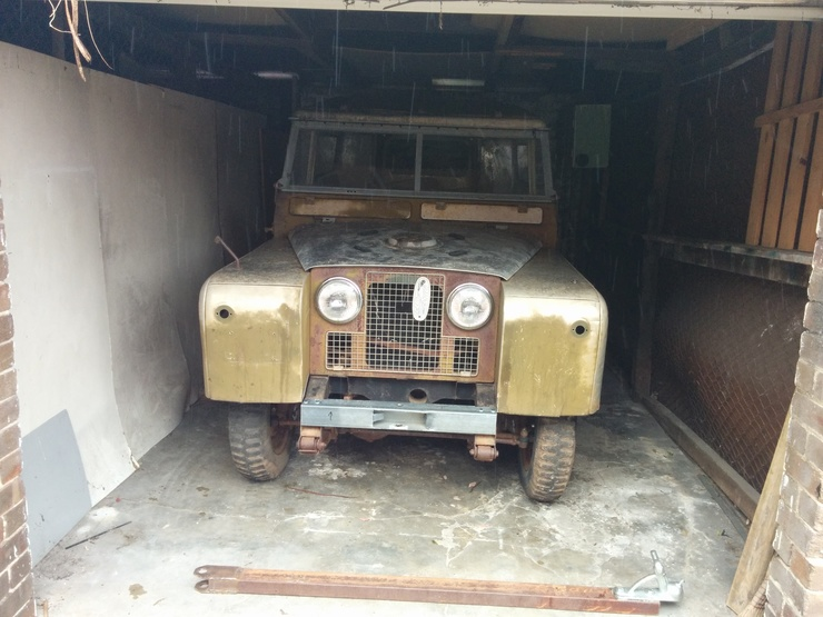 Land Rover in shed