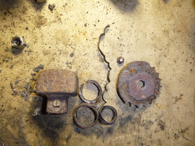 Remnants of counterweight, bimetallic spring, and locking mechanism