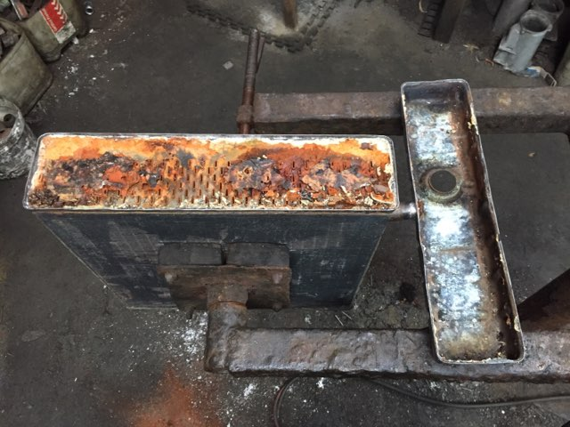 Radiator core and tank before cleaning