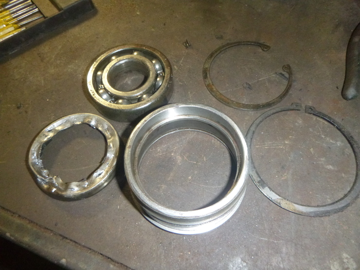 Various components of gearbox rear mainshaft bearing housing