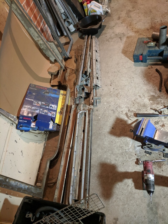 Two piles of longer galvanised parts