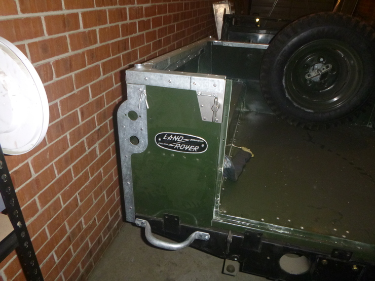 Land Rover badge riveted to rear tub