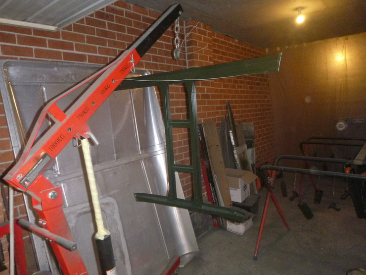 Painted bonnet frame hanging from engine crane