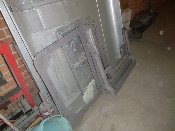 Door frames standing vertically leaning against other panels