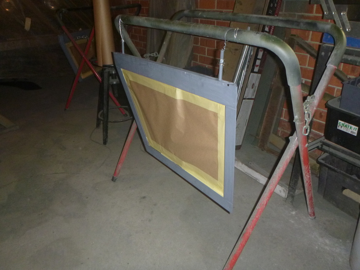 Door top hanging from panel stand with glass masked off